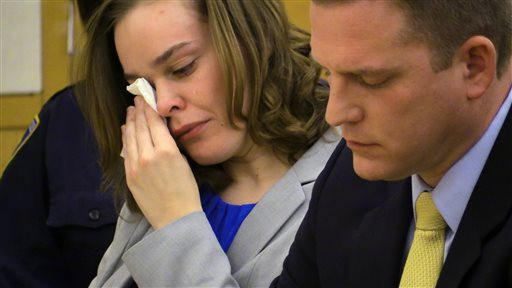 Defendant Lacey Spears wipes tears from her eyes as the prosecutor addresses the court during the opening statements portion of her murder trial at the Westchester County Courthouse in White Plains, N.Y., Tuesday, Feb. 3, 2015. She is accused of...