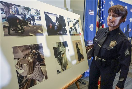 Los Angeles Police detective Meghan Aguilar explains images released by police that could indicate evidence of a suspect holding a police officer's gun, seen in a video shot by a witness at the scene of the shooting of a homeless man on Skid Row...