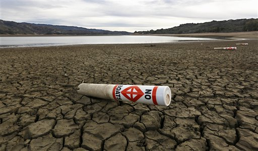 FILE - In this Feb. 4 2014 file photo, a warning buoy sits on the dry, cracked bed of Lake Mendocino near Ukiah, Calif. As bad as the drought in California and the Southwest was last year and in the Midwest a couple years ago, scientists say far...