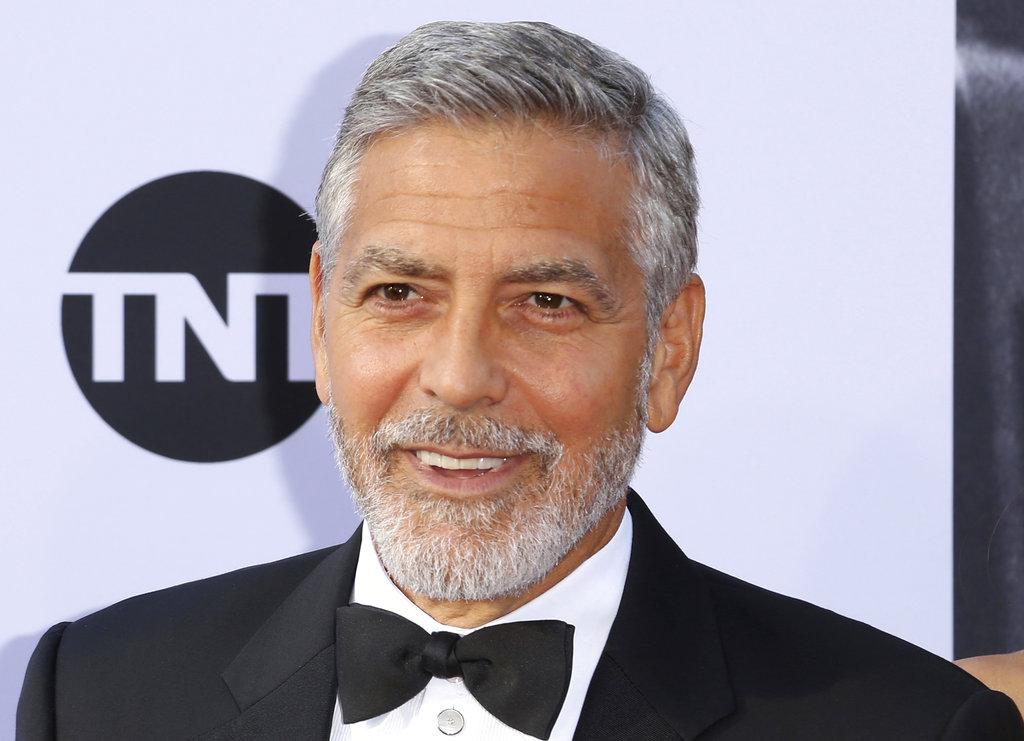 Italy Clooney Hurt_1531226062391