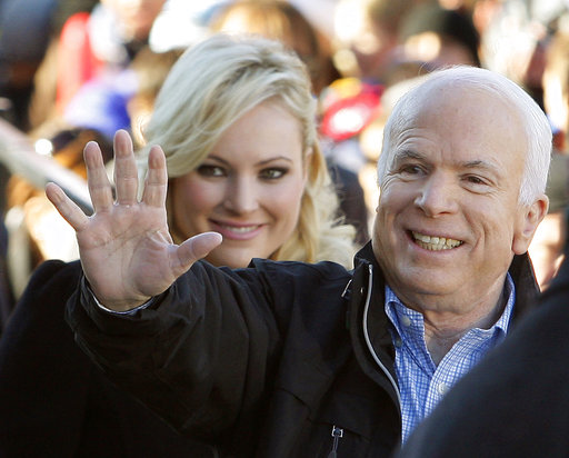 FILE - In this Oct. 30, 20087 file photo, Republican presidential candidate Sen. John McCain, R-Ariz., accompanied by his daughter Meghan McCain, waves to supporters as he enters a campaign rally in Defiance, Ohio.  Former Vice President Joe Biden...