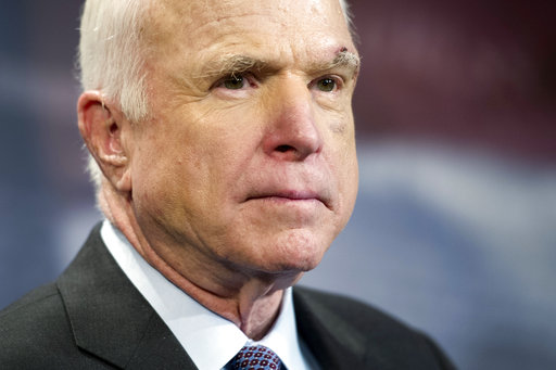 FILE - In this July 27, 2017, file photo, Sen. John McCain, R-Ariz., speaks to reporters on Capitol Hill in Washington. Legislative budget analysts say a possibly doomed Republican health care bill would mean a first-year loss of $1.7 billion of...