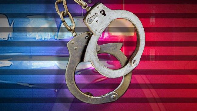 arrest-crime-handcuffs-police-lights_1556812275219.jpg