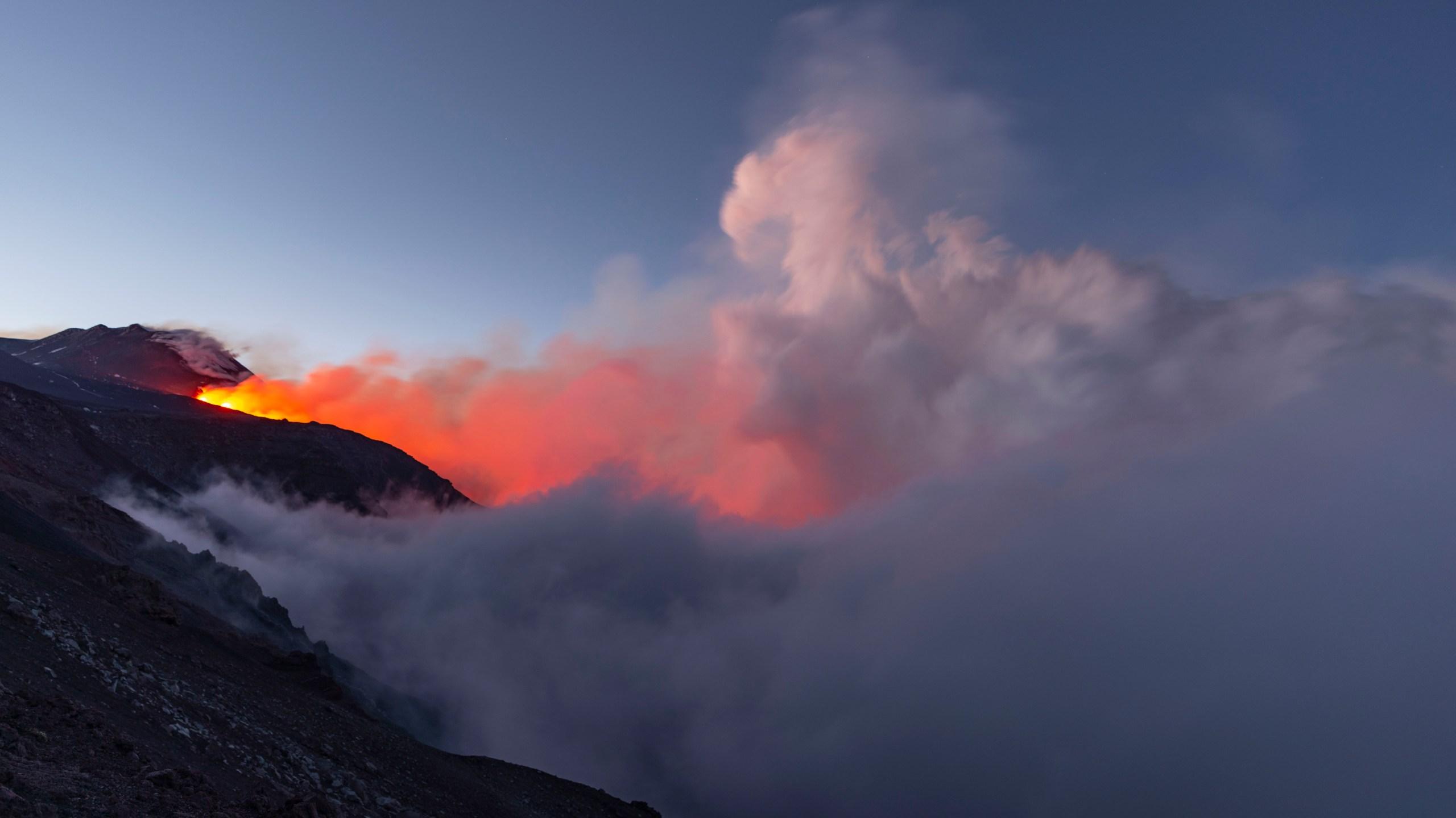 Mount Etna volcano spews lava during an eruption.