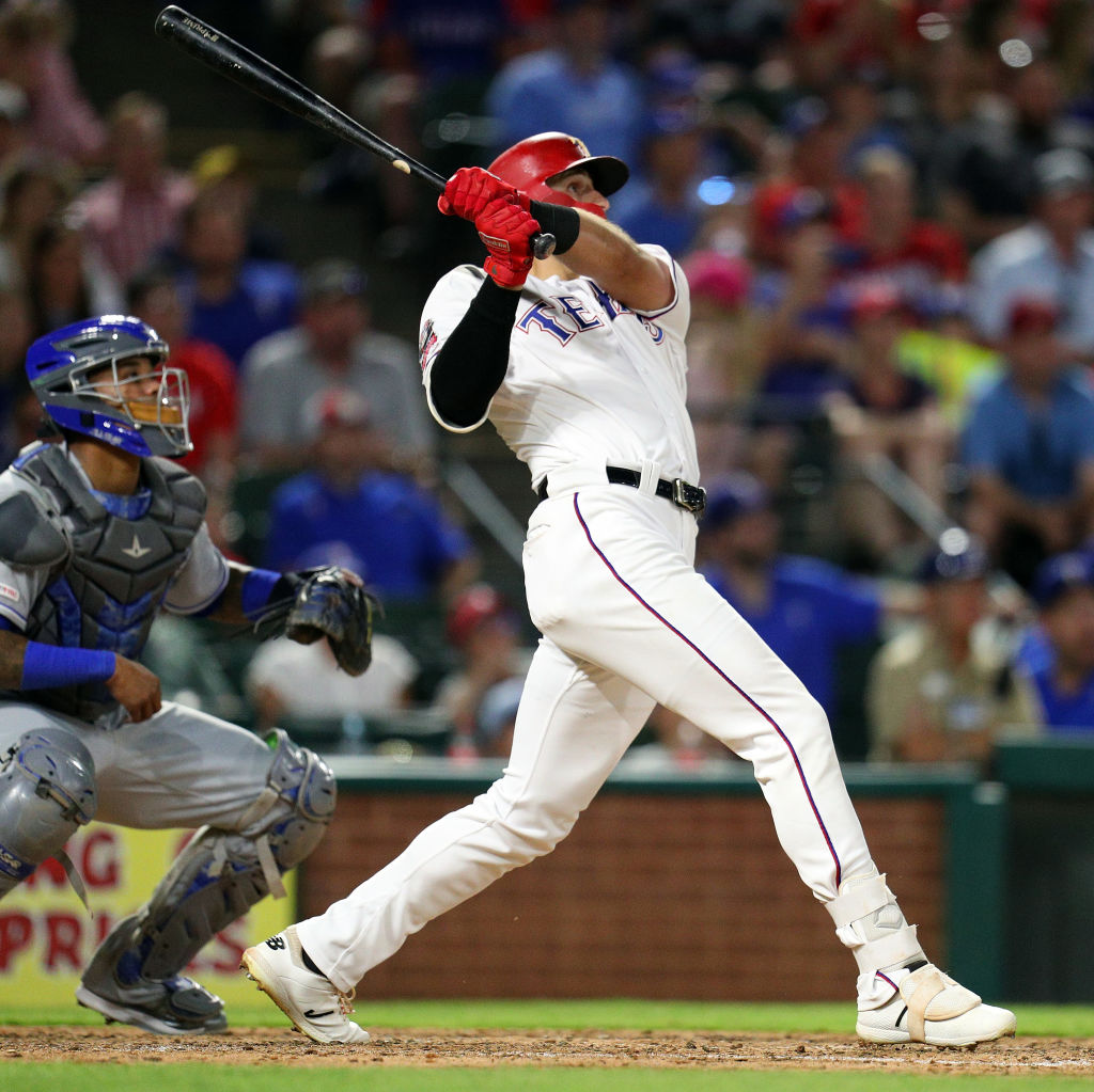 ey Gallo of the Texas Rangers watches his grand slam home run against the Kansas City Royals