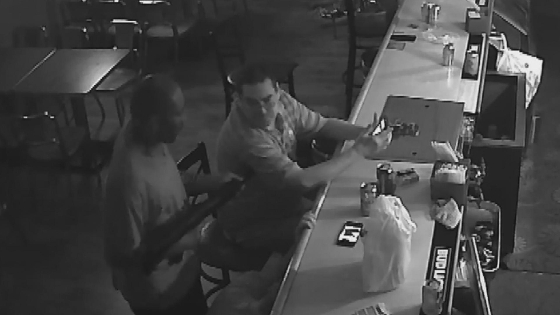 Video shows man refuse to give up phone during armed robbery